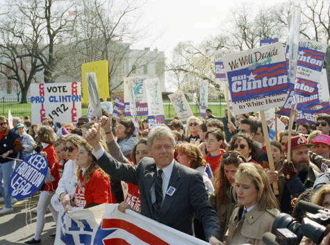 Democratic presidential candidate Bill Clinton marches in front of the White House, 1992