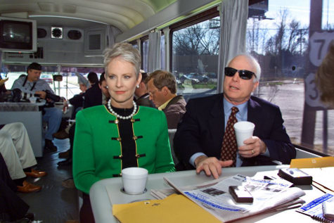 "US Senator John McCain (R-AZ), and his wife Cindy, (L), speak with reporters in Jan 2000 aboard his bus, the ""Straight Talk Express"""